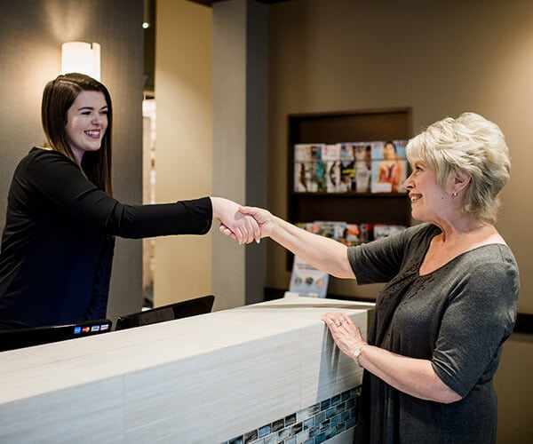 Greeting Patient by Seattle's Best Dentist